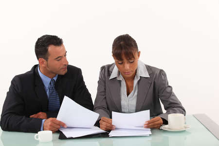 30 to 35: Business professionals reviewing reports Stock Photo