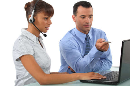 teleconference: businessman and businesswoman working together Stock Photo