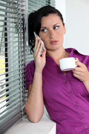 parentheses: Woman with telephone and coffee cup