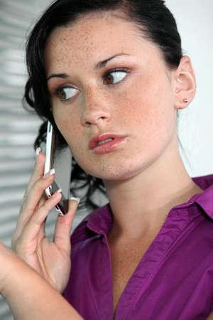Anxious businesswoman making call Stock Photo - 15622976