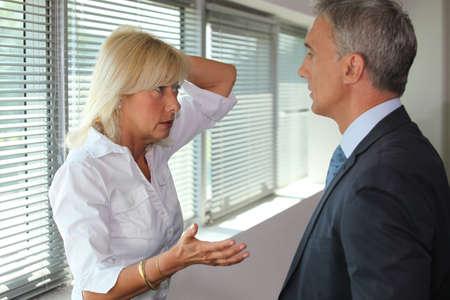 persuading: Senior executives having heated debate Stock Photo