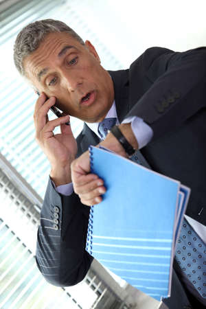 forgetful: Shocked businessman realizing he is late