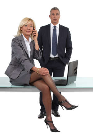 smart businessman and businesswoman, studio shot photo