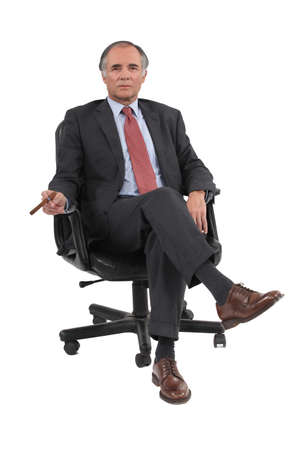 crossed legs: Businessman sitting in a swivel chair Stock Photo