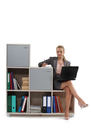 table skirt: Woman sat on office furniture