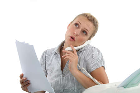 Woman on the phone next to a fax machine photo