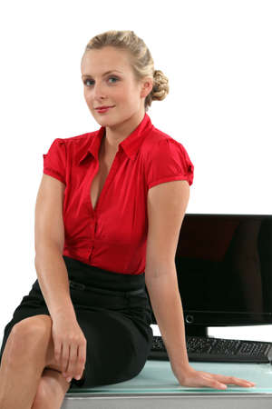 personal assistant: Blond personal assistant sat on desk