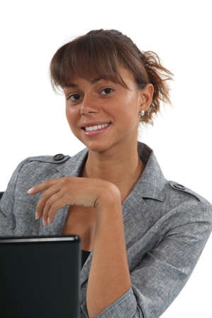 Young woman in front of a computer Stock Photo - 15623421