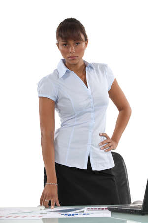 strict: Serious employee in front of her desk