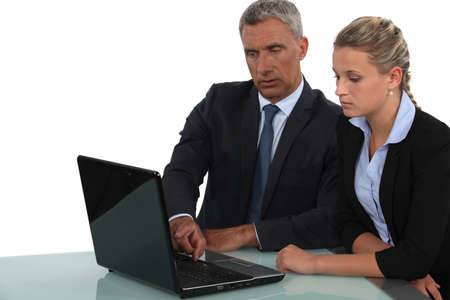 55 60 years: Business professionals working together Stock Photo