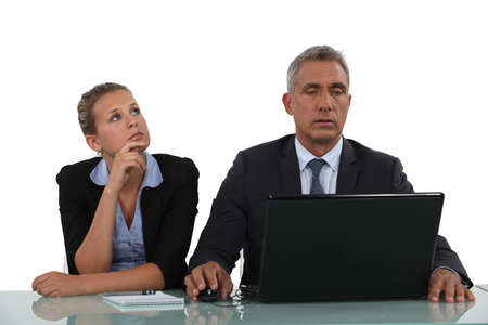 envisage: businessman and his assistant working together Stock Photo