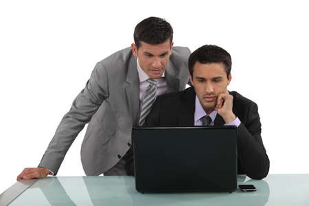 crucial: Business partners reading an e-mail together Stock Photo