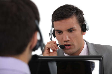 call center: Two male call-center workers