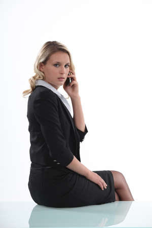 unfriendly: Austere businesswoman talking on her mobile phone Stock Photo