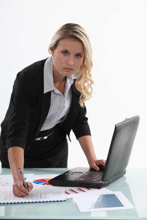 sales representative: Saleswoman in office Stock Photo