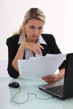 stockings woman: blonde  businesswoman going through files