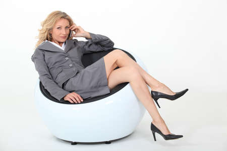 legs folded: Businesswoman in a chair