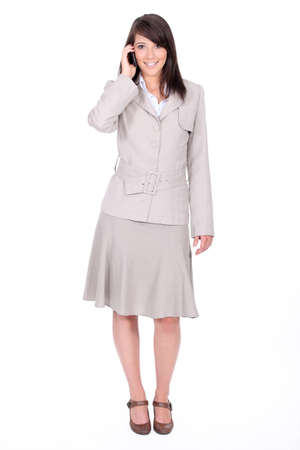 gray suit: Girl with skirt and jacket on the phone Stock Photo