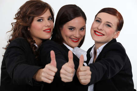 non verbal: Businesswomen giving the thumb