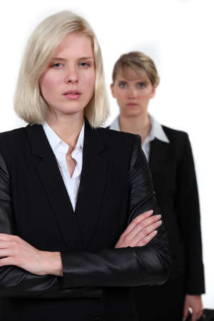 mean: Stern looking businesswomen