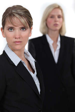 poker faced: Serious businesswomen Stock Photo