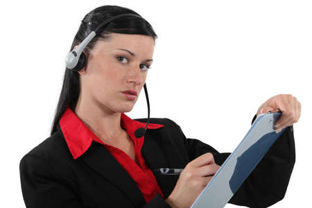 adaptable: Woman with headphones and microphone writing