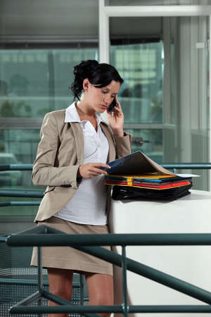 offset view: Businesswoman with folders Stock Photo