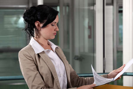 gen: Businesswoman reading a document Stock Photo