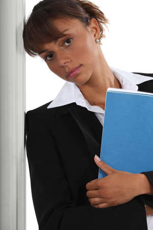 glum: Serious businesswoman with file