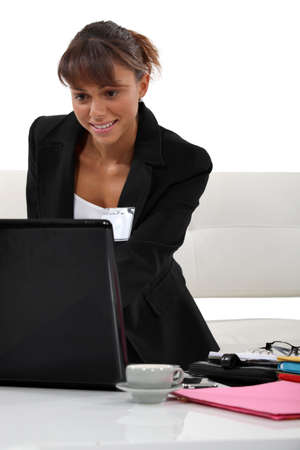 Smiling employee at her desk Stock Photo - 15672243