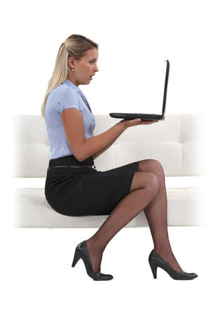 tight fitting: Shocked businesswoman reading an e-mail Stock Photo