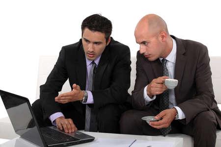 associates: Associates discussing their business plan Stock Photo