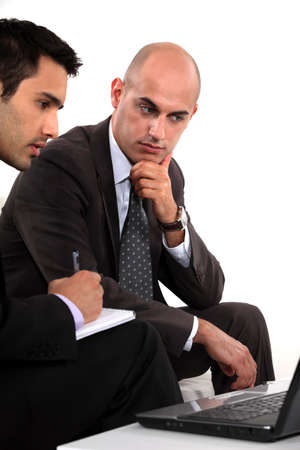 Two businessmen problem solving photo