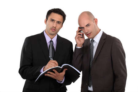 Serious businessmen with a cellphone Stock Photo - 15672021