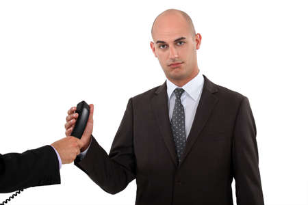 crucial: Businessman taking a phone call Stock Photo