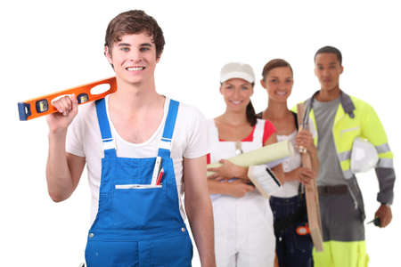 apprentice craftsman holding a level photo