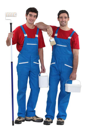 painter and decorator: Two decorators dressed in the exact same outfit Stock Photo