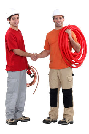 craftsman and apprentice shaking hands photo