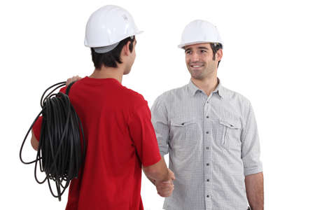 electricians shaking hands photo