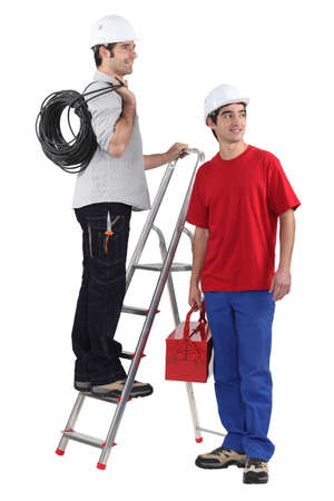 Two electrician about to start work Stock Photo - 15686390