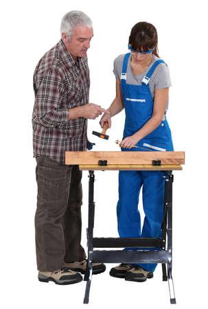 Carpenter training young female apprentice Stock Photo - 15674957
