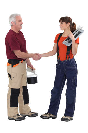 craftsman and craftswoman shaking hands photo