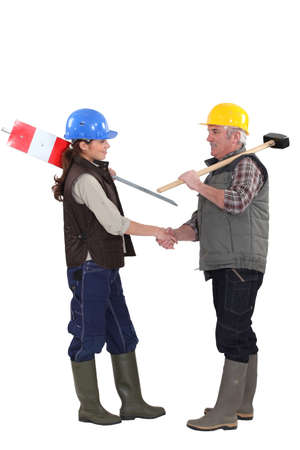 Construction workers shaking hands photo