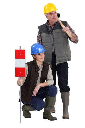 young female apprentice and senior carpenter photo