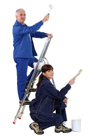 kneeled: A couple of painters  Stock Photo