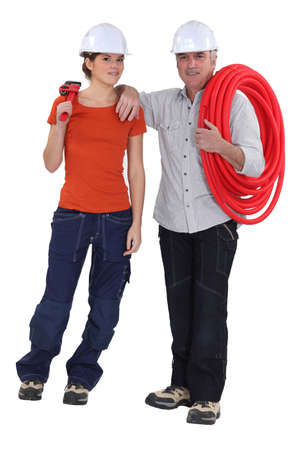 An experienced plumber and his apprentice Stock Photo - 15675157