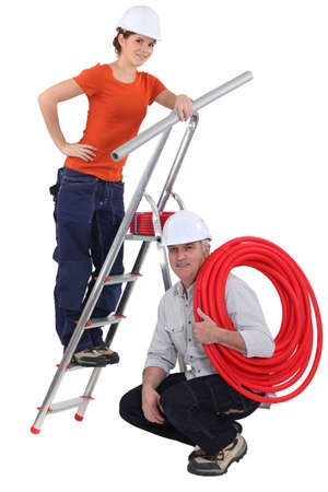 two plumbers working together photo