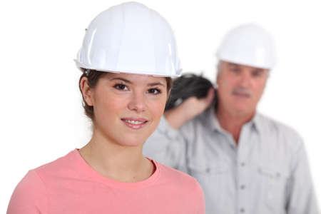 workwoman: Portrait of a young tradeswoman with her boss in the background
