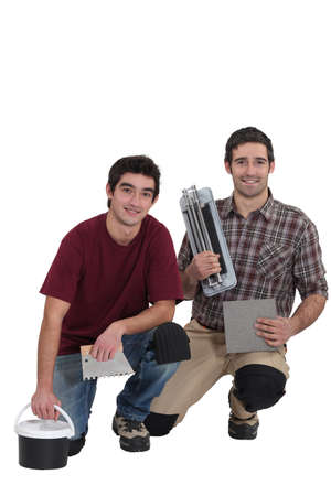 Tile cutter and plasterer Stock Photo - 15673286