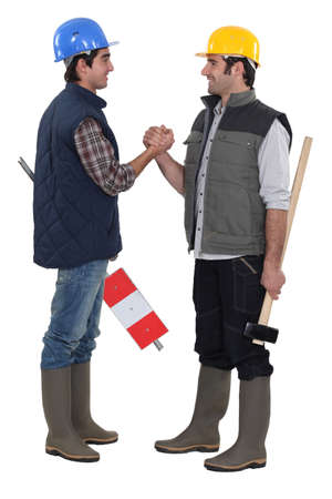 Tradesmen forming a pact Stock Photo - 15673012